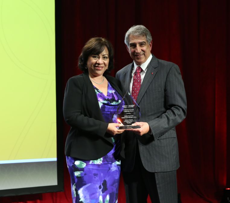 Esther López, UFCW's International Secretary-Treasurer, accepts the National Corporate Leadership Award from Louis J. DeGennaro, Ph.D., LLS's president and CEO, at LLS's Volunteer Leadership Conference awards dinner held in Washington, D.C., on May 2, 2017.
